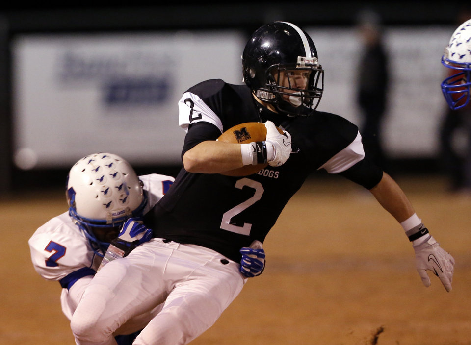 Photo - Meeker's Dallas Jackson runs and as the Millwood Falcons play the Meeker Bulldogs in state high school football playoffs on Friday, Nov. 29, 2013, in Meeker, Okla.  Photo by Steve Sisney, The Oklahoman