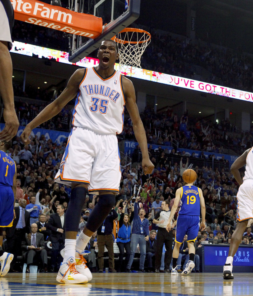 Oklahoma City's Kevin Durant (35) reacts after a dunk during the NBA basketball game between the Oklahoma City Thunder and the Golden State Warriors at the Oklahoma City Arena, Tuesday, March 29, 2011. Photo by Bryan Terry, The Oklahoman