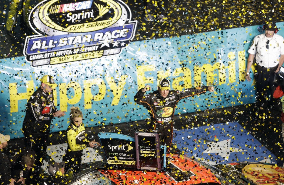 Photo - Jamie McMurray celebrates after winning the NASCAR Sprint All-Star auto race at Charlotte Motor Speedway in Concord, N.C., Saturday, May 17, 2014. (AP Photo/Gerry Broome)