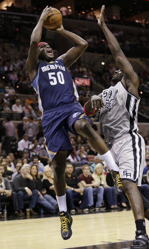 Memphis Grizzlies' Zach Randolph (50) shoots over San Antonio Spurs' DeJuan Blair during the first quarter of an NBA basketball game, Saturday, Dec. 1, 2012, in San Antonio. (AP Photo/Eric Gay)