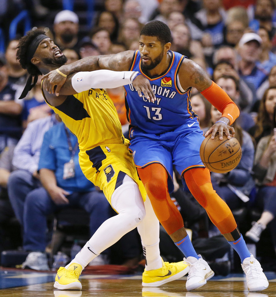 Photo - Oklahoma City's Paul George (13) works against Indiana's Wesley Matthews (23) in the third quarter during an NBA basketball game between the Indiana Pacers and the Oklahoma City Thunder at Chesapeake Energy Arena in Oklahoma City, Wednesday, March 27, 2019. Oklahoma City won 107-99. Photo by Nate Billings, The Oklahoman