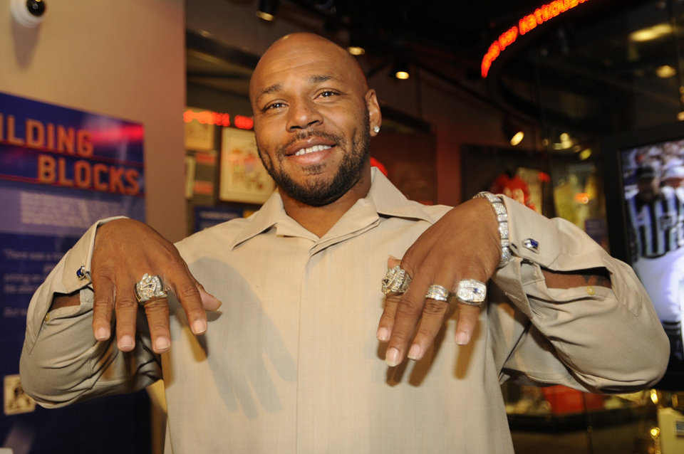 New England Patriots running back Kevin Faulk shows off his three Super Bowl rings and a divisional championship ring at a news conference were he announced his retirement from NFL football on Tuesday, Oct. 9, 2012, in Foxborough, Mass. In his 13 seasons with the Patriots, Faulk rushed for 3,607 yards and 16 touchdowns and caught 431 passes for 3,701 yards and 15 touchdowns. (AP Photo/The Boston Herald, Ted Fitzgerald) BOSTON GLOBE OUT; METRO BOSTON OUT; MAGS OUT; ONLINE OUT