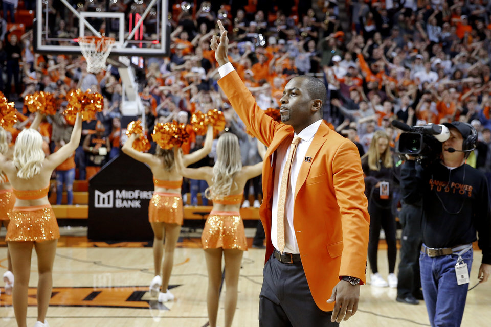 Photo - Oklahoma State coach Mike Boynton signals toward the crowd after an NCAA men's Bedlam basketball game between the Oklahoma State University Cowboys (OSU) and the University of Oklahoma Sooners (OU) at Gallagher-Iba Arena in Stillwater, Okla., Saturday, Feb. 22, 2020. Oklahoma State won 83-66. [Bryan Terry/The Oklahoman]