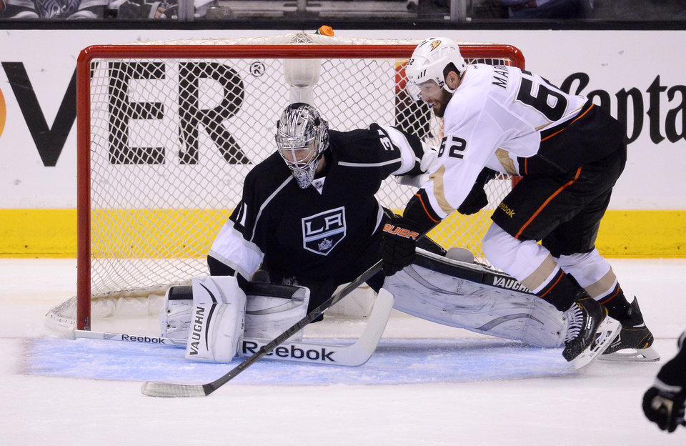 Photo - Anaheim Ducks left wing Patrick Maroon, right, tries to get a shot in on Los Angeles Kings goalie Martin Jones during the third period in Game 4 of an NHL hockey second-round Stanley Cup playoff series, Saturday, May 10, 2014, in Los Angeles. The Duck won 2-0. (AP Photo/Mark J. Terrill)