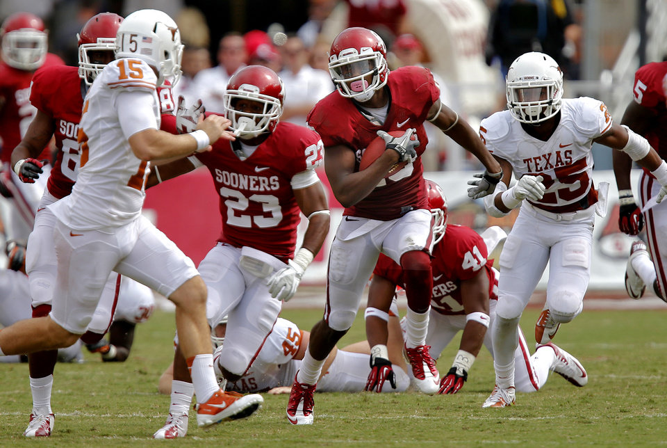 OU\'s Justin Brown (19) returns a kick past UT\'s Alex King (15) during the Red River Rivalry college football game between the University of Oklahoma (OU) and the University of Texas (UT) at the Cotton Bowl in Dallas, Saturday, Oct. 13, 2012. Photo by Chris Landsberger, The Oklahoman