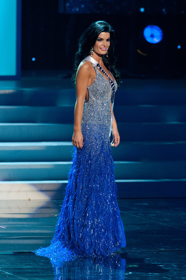 Photo -   In this photo provided by the Miss Universe Organization, Miss Pennsylvania Sheena Monnin competes during the 2012 Miss USA Presentation Show on Wednesday, May 30, 2012 in Las Vegas. Monnin resigned her crown claiming the contest is rigged, but according to organizers the beauty queen was upset over the decision to allow transgender contestants to enter. A posting on Monnin's Facebook page claims another contestant learned the names of the top 5 finishers on Sunday morning, hours before the show was broadcast. (AP Photo/Miss Universe Organization, Darren Decker)