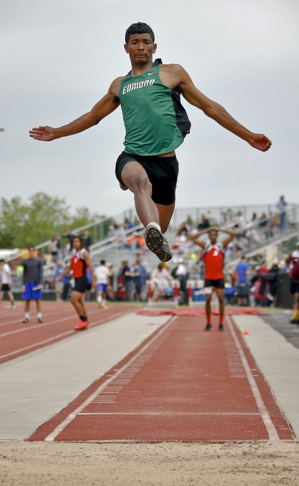 Photo - Edmond Santa Fe's Josiah Hunter  competes in the Class 6A boys long during the Class 6A and 5A state championship track meet at Yukon High School on Saturday, May 17, 2014 in Yukon, Okla.   Photo by Chris Landsberger, The Oklahoman