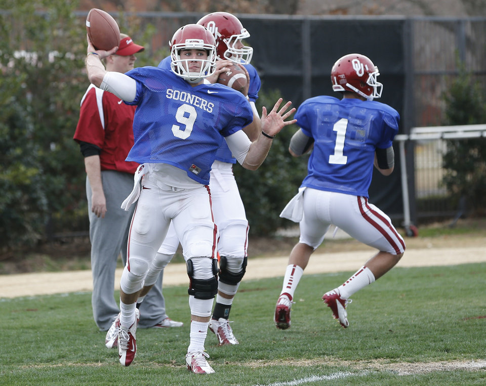 FILE - In this Tuesday, March 12, 2013, file photo, Oklahoma quarterbacks Trevor Knight (9) and Kendal Thompson (1) throw during  spring NCAA college football practice in Norman, Okla.  The competition to replace starting quarterback Landry Jones will go in front of the public eye for likely the only time when Oklahoma plays its spring game Saturday. Blake Bell, Kendal Thompson and Trevor Knight have been competing for the job during the Sooners' closed practices. (AP Photo/Sue Ogrocki, File) ORG XMIT: OKSO102