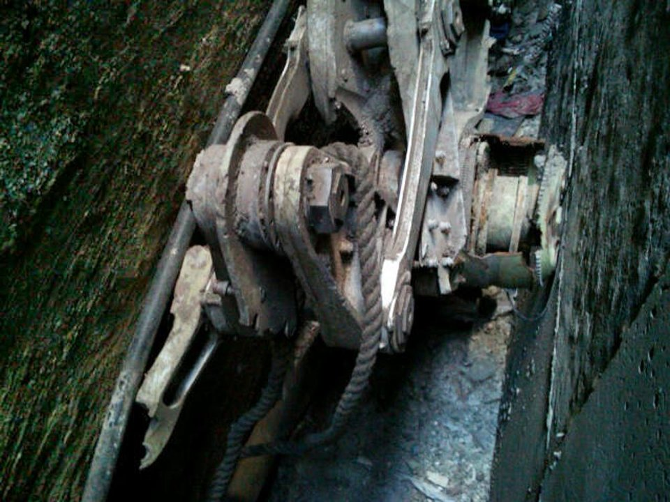 This Friday, April 26, 2013, photo provided by the New York City Police Department shows a piece of landing gear that authorities believe belongs to one of the airliners that crashed into the World Trade Center on Sept. 11, 2001, that was found wedged between a mosque and another building, in New York. Police say the medical examiner\'s office will complete a health and safety evaluation to determine whether to sift the soil around the buildings for possible human remains. (AP Photo/New York City Police Department)