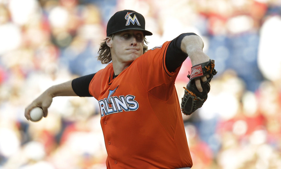 Photo - Miami Marlins' Tom Koehler throws in the first inning of a baseball game against the Philadelphia Phillies, Thursday, June 26, 2014, in Philadelphia. (AP Photo/Laurence Kesterson)