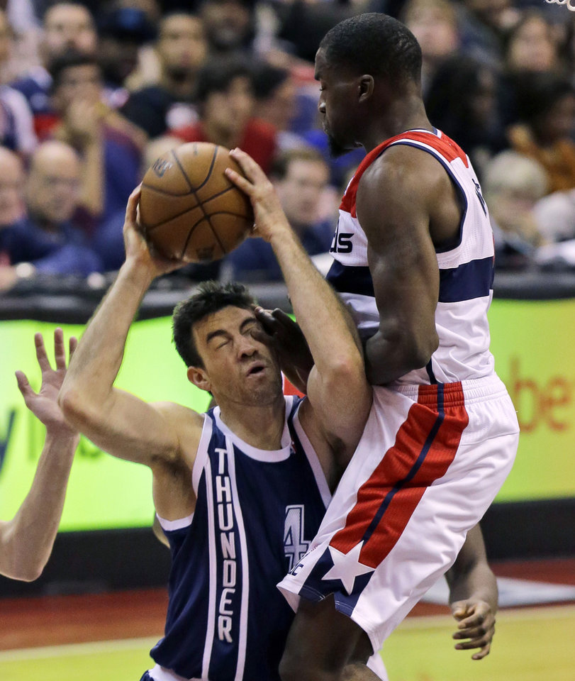 Oklahoma City�s Nick Collison, left, collides with Wizards forward Martell Webster in the second half Monday in Washington. The Wizards won 101-99. AP Photo
