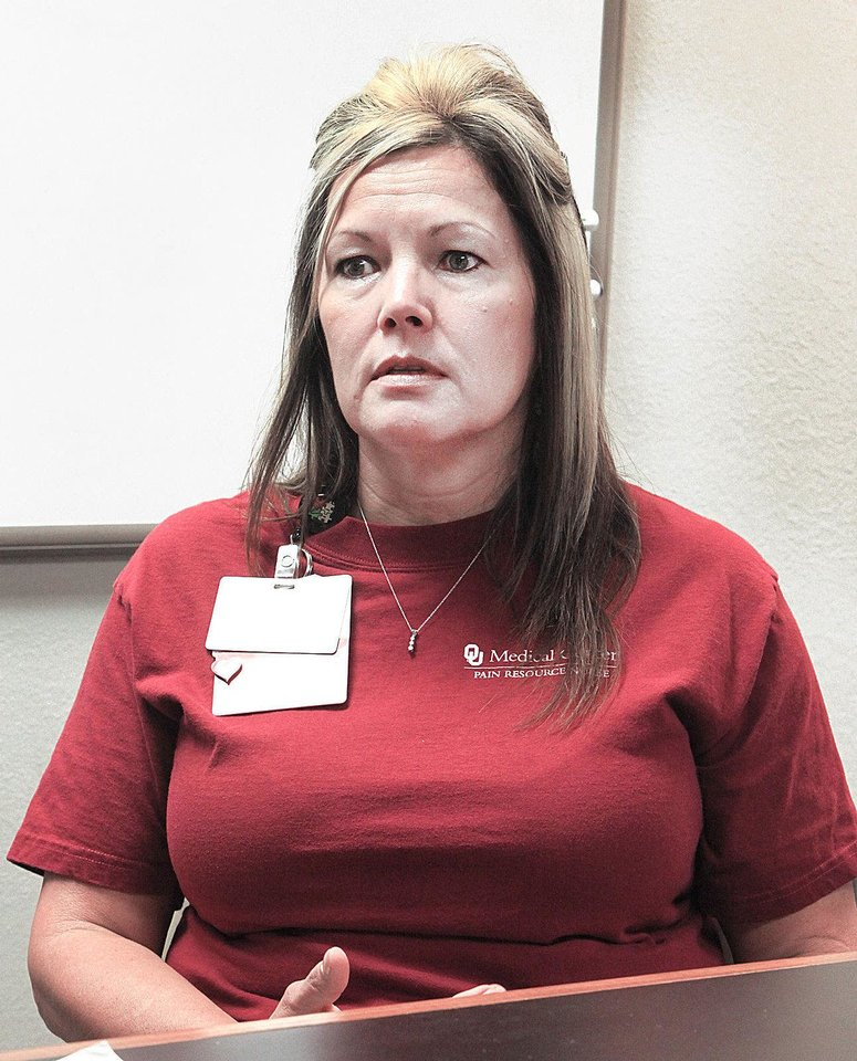 Dana Klingenburg, a nurse at OU Medical Center, discusses her daughter's recent black widow spider bite. Photo by David McDaniel, The Oklahoman
