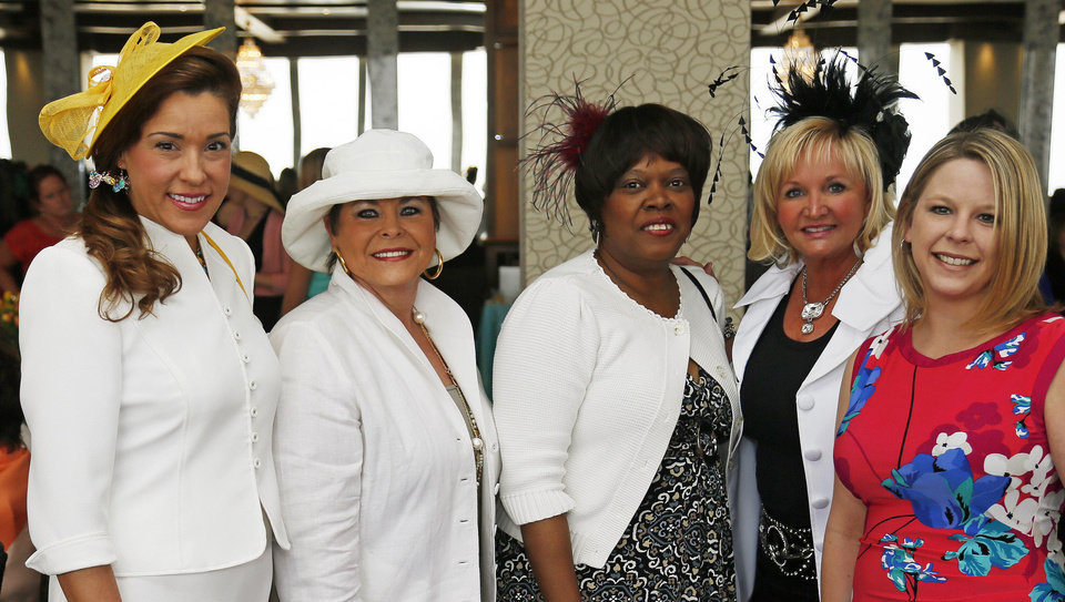 From left, Darla Zuhdi, Cheryl Clements, Rhonda Thomas, Cindy Sparkman and Tami Loch pose for a photo at the Women of the South\'s 3rd annual Magnolia Brunch in the Petroleum Club in Oklahoma City, Saturday, April 20, 2013. Photo by Nate Billings, The Oklahoman