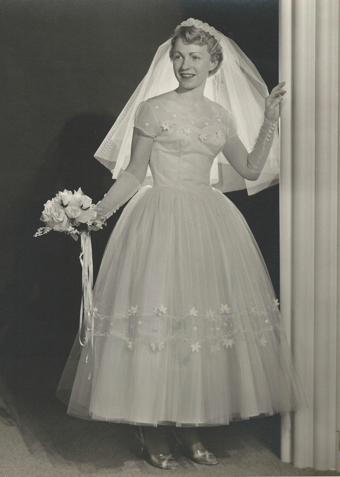 Photo - The shorter hemline on Velma Lee Smith Koelsch's ice blue gown  helped her fit in with  trends of the 1950s. She was married in May 1957. Photo provided by Robbin Koelsch.  PROVIDED
