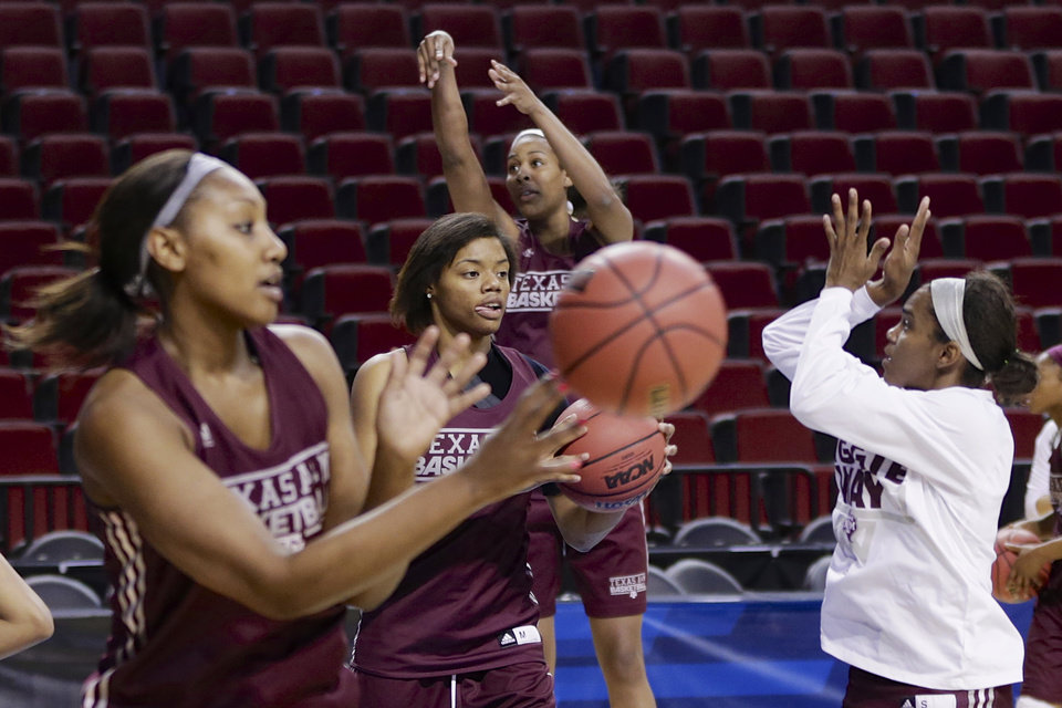 Photo - Texas A&M's Courtney Williams, center, and teammates participate in drills during NCAA college basketball practice in Lincoln, Neb., Friday, March 28, 2014. Texas A&M will play DePaul in an NCAA Lincoln Regional women's semifinal basketball game on Saturday. (AP Photo/Nati Harnik)