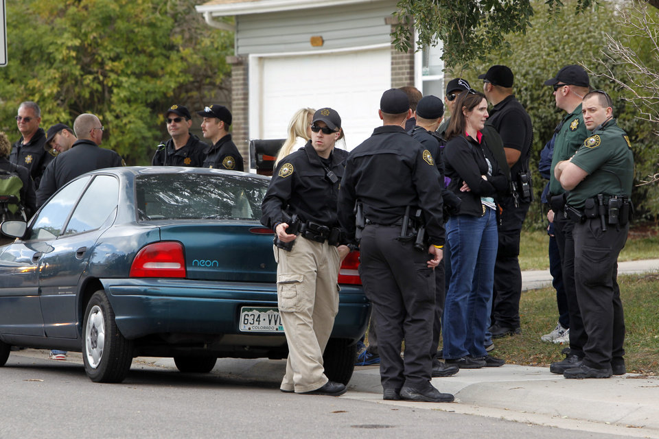 Photo -   Police gather after canvassing a neighborhood looking for clues in the search for ten-year-old Jessica Ridgeway near her home in Westminster, Colo., on Wednesday, Oct. 10, 2012. The youngster has been missing since she left her home Friday morning on her way to school. (AP Photo/Ed Andrieski)
