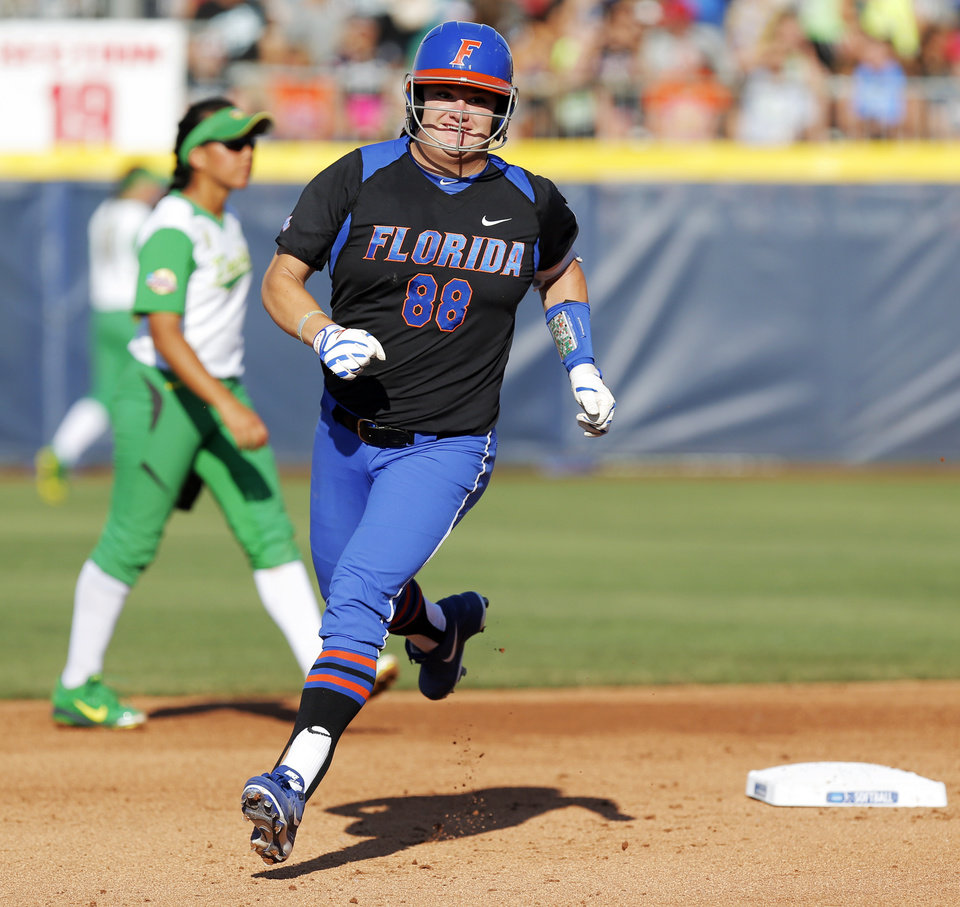 Photo - Florida's Bailey Castro (88) runs the bases after hitting a home run in the 2nd inning during Game 5 of the Women's College World Series softball tournament between Florida and Oregon at ASA Hall of Fame Stadium in Oklahoma City, Friday, May 30, 2014. Photo by Nate Billings, The Oklahoman
