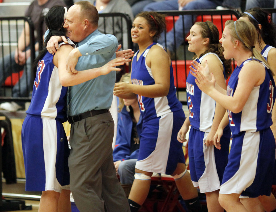 Hammon coach Lance Carpenter hugs Peyton Walker (23) as the Lady Warriors celebrate their win over Erick during a Class B girls high school basketball area playoff game at Yukon High School in Yukon,  Okla., Friday, Feb. 24, 2012. Hammon advanced to the state tournament with the win. Photo by Nate Billings, The Oklahoman