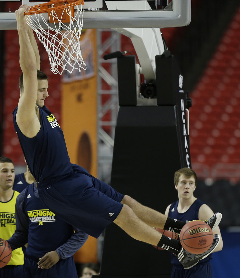 Photo - Michigan's Mitch McGary comes off the court  during practice of the NCAA Final Four tournament college basketball semifinal game Friday, April 5, 2013, in Atlanta. Michigan plays Syracuse in a semifinal game on Saturday. (AP Photo/John Bazemore)