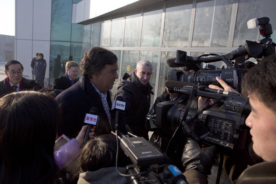 Photo - Former Governor of New Mexico Bill Richardson is surrounded by journalists as he walks into the Pyongyang International Airport in Pyongyang, North Korea as he and Google Chief Executive Eric Schmidt, not seen, depart for Beijing on Thursday, Jan. 10, 2013. (AP Photo/David Guttenfelder)