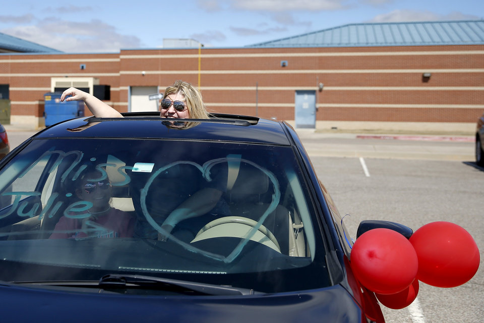 Photo - Julie Rutledge, a secretary Oakridge Elementary, waits in a car before an  Oakridge Elementary faculty caravan through neighborhoods around the Moore school, Tuesday, March 24, 2020. [Bryan Terry/The Oklahoman]