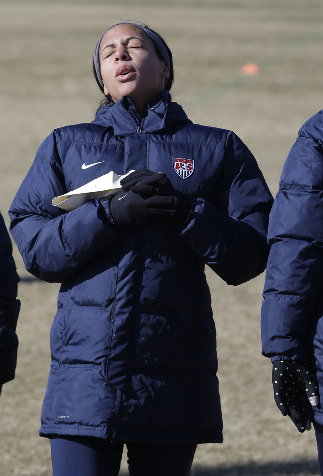 Photo - In this photo made Tuesday, Jan. 28, 2014, U.S. women's soccer team player Sydney Leroux reacts to the cold weather  during practice in Frisco, Texas. The U.S. women's soccer team opens its season against Canada in Texas on Friday, Jan. 31, their second meeting since the 2012 Olympic match. (AP Photo)