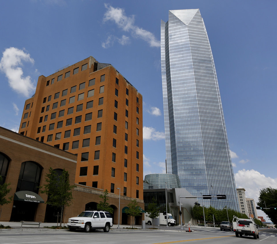"The Greater Oklahoma City Chamber on Tuesday reported that Class A office space downtown is virtually non-existant despite the opening last year of the 50-story Devon Energy Center, shown to the right. Nicholas Preftakes, owner of the One North Hudson Building, left, is emptying the building for future ""redevelopment."" <strong>Steve Gooch</strong>"