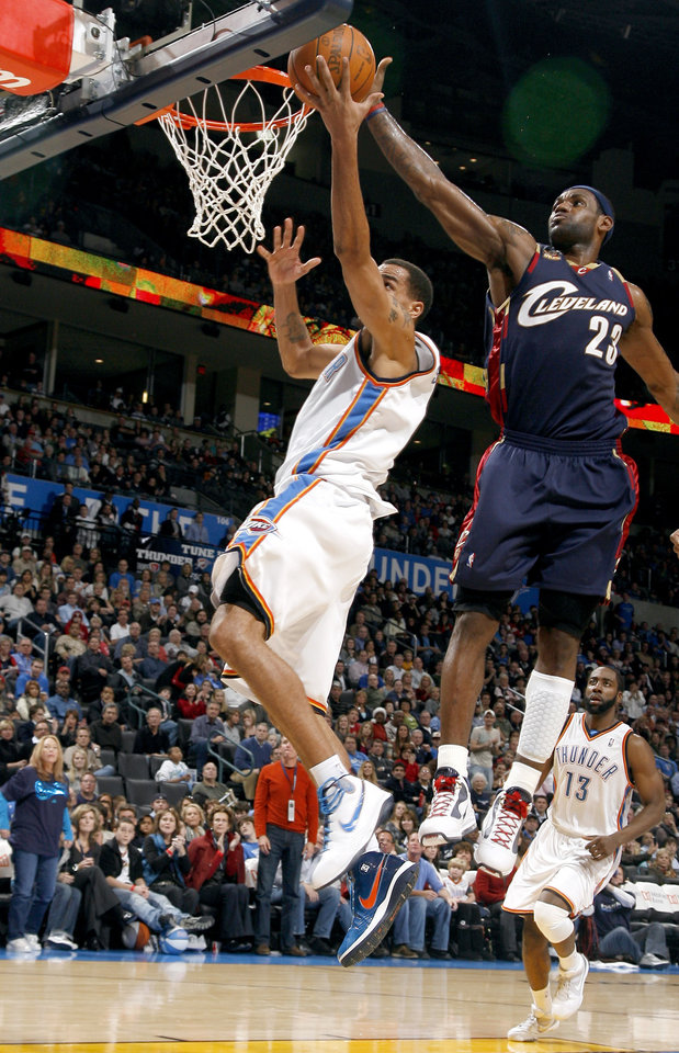 Photo - Cleveland's LeBron James (23) blocks Oklahoma City's Thabo Sefolosha's lay up during the NBA game between the Oklahoma City Thunder and the Cleveland Cavaliers, Sunday, Dec. 13, 2009, at the Ford Center in Oklahoma City. Photo by Sarah Phipps, The Oklahoman