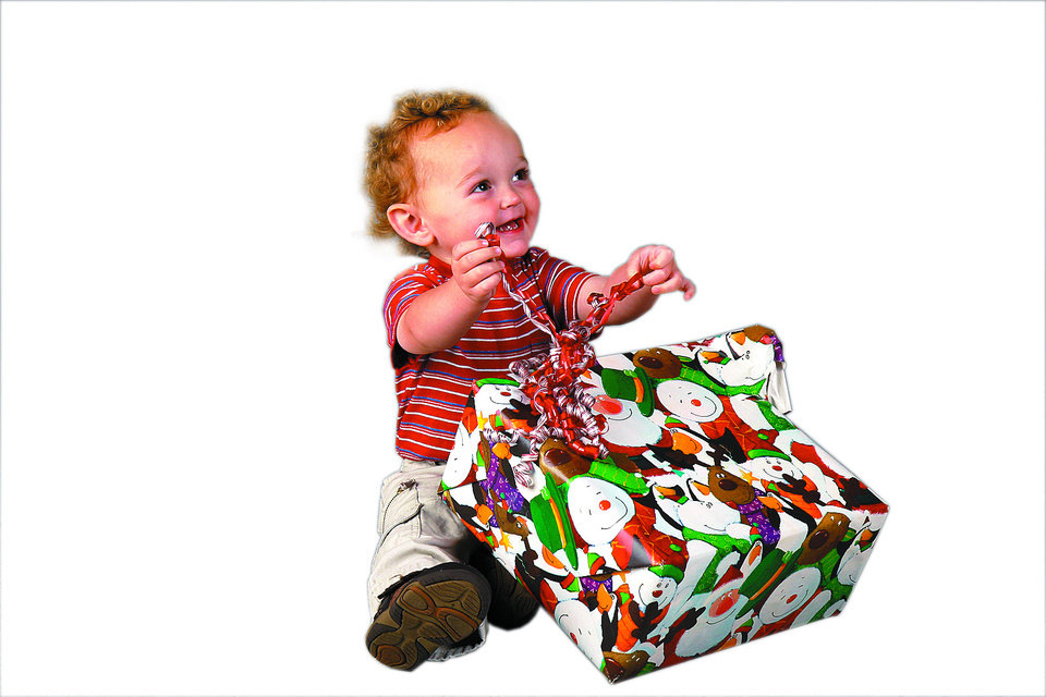 Photo - Gabe McDonnell, who turns 2 Friday and is entertainment writer Brandy McDonnell's son, opens a present. PHOTO BY DOUG HOKE THE OKLAHOMAN