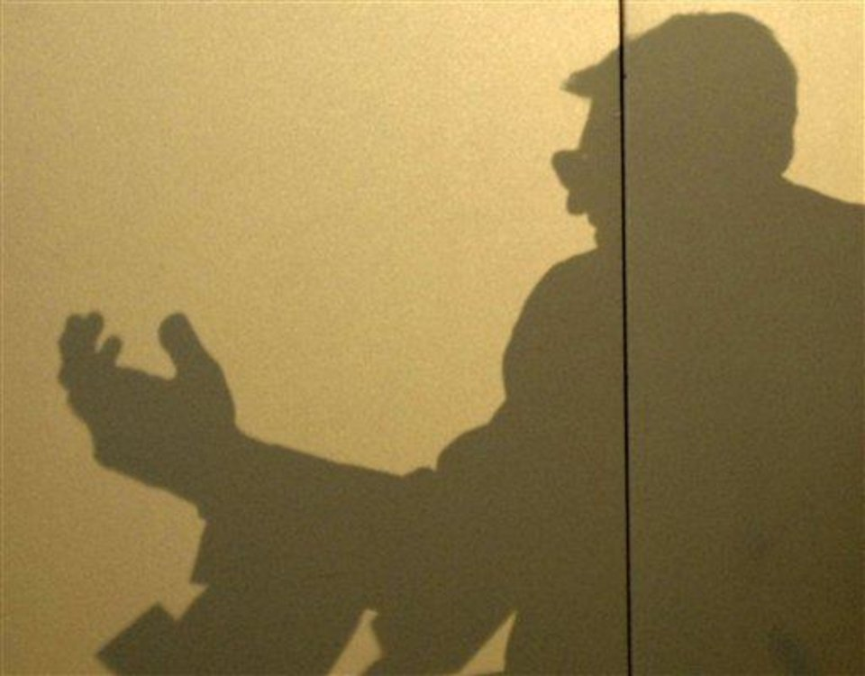 Photo - The shadow of Penn State head football coach Joe Paterno is projected on a wall during a news conference where he discussed the upcoming football season at a university alumni event Saturday, June 9, 2007, in Camp Hill, Pa. (AP Photo/Bradley C Bower)