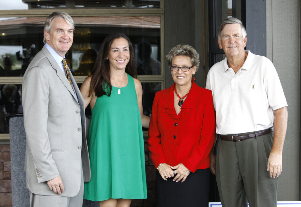 Photo - Kirk Hall, Chairman and President of the Fred Jones Family Foundation, Wendy Smith, Vice President of the Fred Jones Family Foundation, Janet Peery, CEO of  YWCA Oklahoma City, and Brooks Hall, Jr., Fred Jones Family Foundation board Vice President, attending an announcement Tuesday, Aug. 13, 2013, of a $75,000 grant from the Fred Jones Family Foundation to YWCA Oklahoma City to provide updates to fencing, security, and landscaping of the YWCA OKC Facility. The Fred Jones Family Foundation announced that YWCA Okla. City is the recipient of their 2013 Mary Eddy Jones Signature Gift. Photo by Paul B. Southerland, The Oklahoman