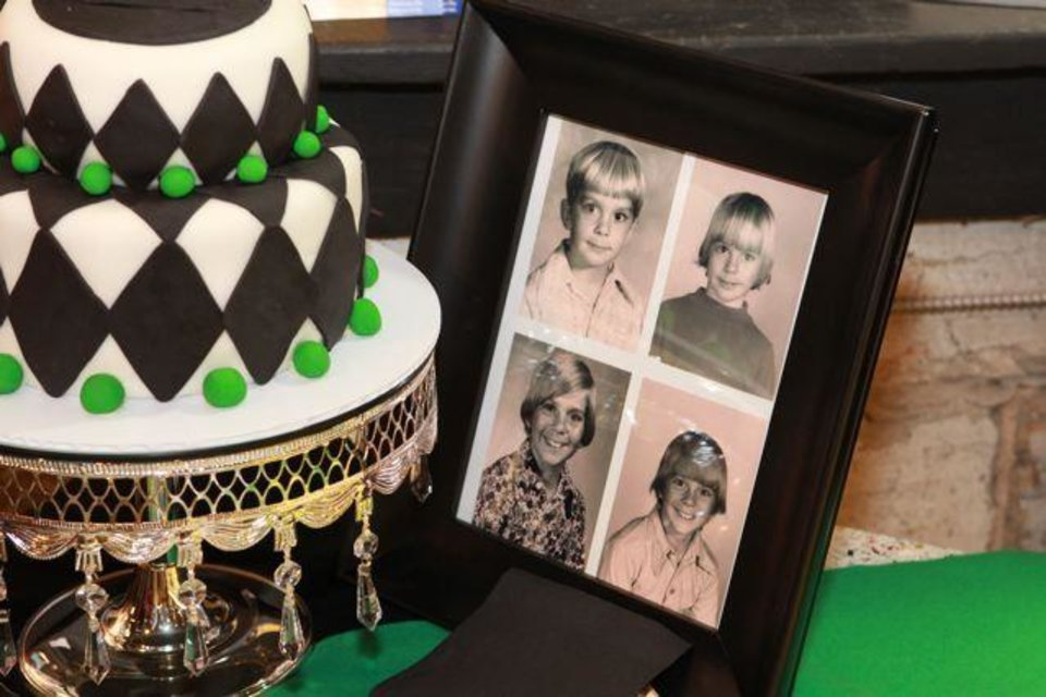 Photo -  SURPRISING BLAKE...Blake Gibson's birthday cake with an argyle them. Golf decorations were also set around the room along with childhood pictures of Blake Gibson. (Photo provided).