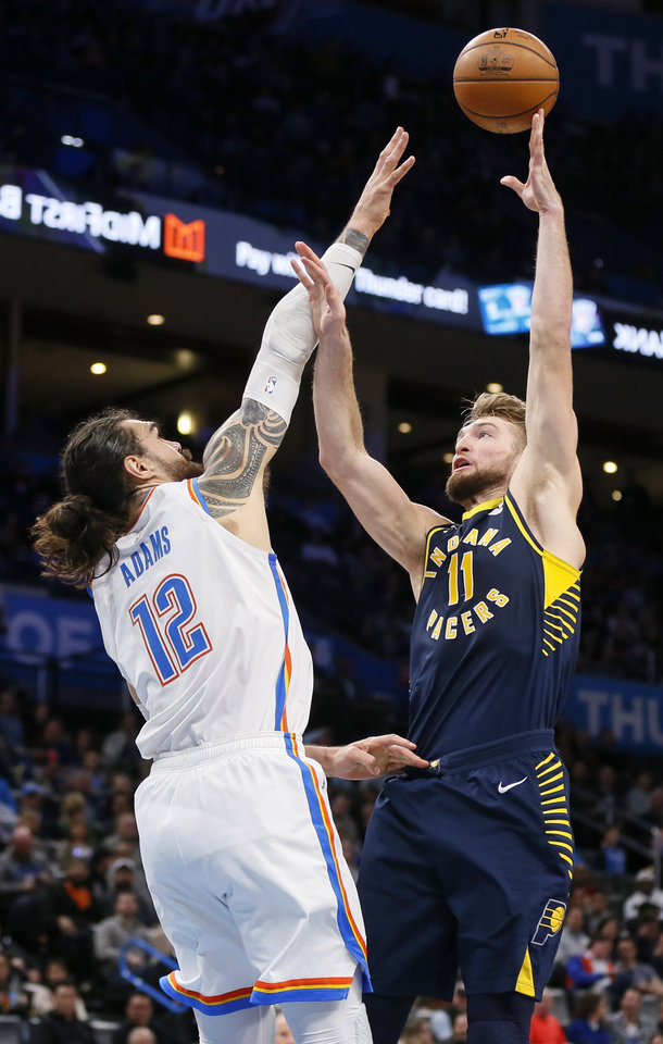 Photo - Domantas Sabonis (11) shoots over Oklahoma City's Steven Adams (12) in the third quarter during an NBA basketball game between the Indiana Pacers and the Oklahoma City Thunder at Chesapeake Energy Arena in Oklahoma City, Wednesday, Dec. 4, 2019. Indiana won 107-100. [Nate Billings/The Oklahoman]