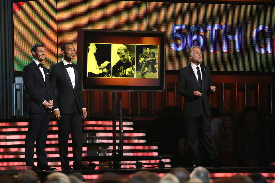 Photo - Ryan Seacrest, from left, John Legend and President of the National Academy of Recording Arts & Sciences Neil Portnow speak on stage at the 56th annual Grammy Awards at Staples Center on Sunday, Jan. 26, 2014, in Los Angeles. (Photo by Matt Sayles/Invision/AP)
