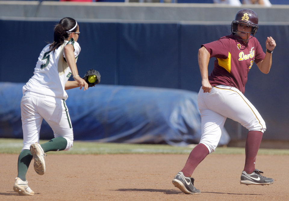 Photo - Baylor's Dani Leal (5) chases down during Arizona State's Mandy Urfer (36)he Women's College World Series game between Arizona State and Baylor at the ASA Hall of Fame Stadium in Oklahoma City, Sunday, June 5, 2011. Photo by Garett Fisbeck, The Oklahoman