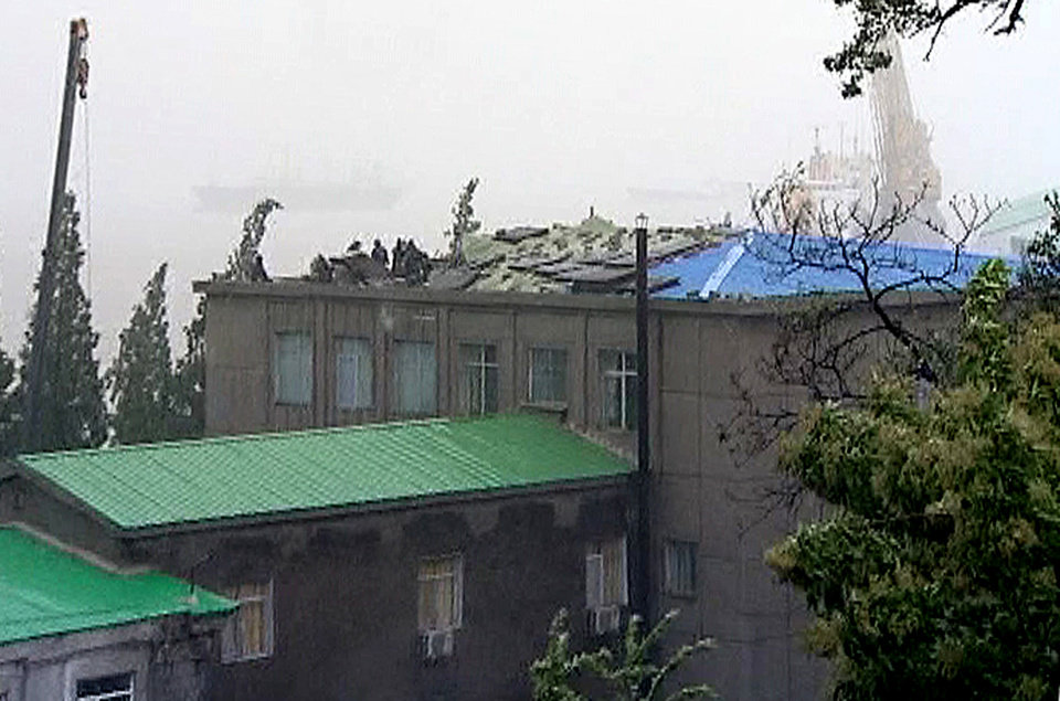 In this image made off North Korea's Korean Central News Agency video footage, the roof of a building is seen half collapsed in Nampho, North Korea, on Tuesday, Aug. 28, 2012 after a typhoon hit the area. A second typhoon in less than a week is approaching North Korea, threatening more rain in a country where storms often mean catastrophe because of deforestation deforestation and fragile infrastructure. (AP Photo/Korean Central News Agency)