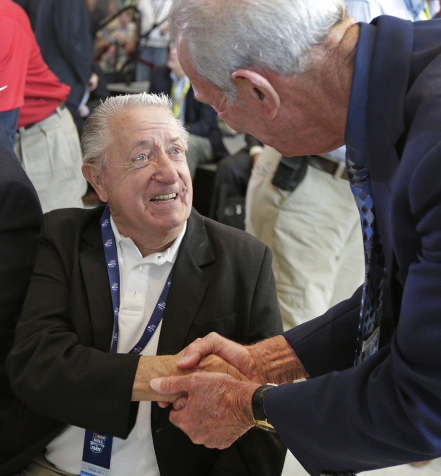 Photo - Rex White, left, is congratulated by Ned Jarrett, right, after being named as one of five inductees into the NASCAR Hall of Fame class of 2015 during an announcement in Charlotte, N.C., Wednesday, May 21, 2014. (AP Photo/Chuck Burton)