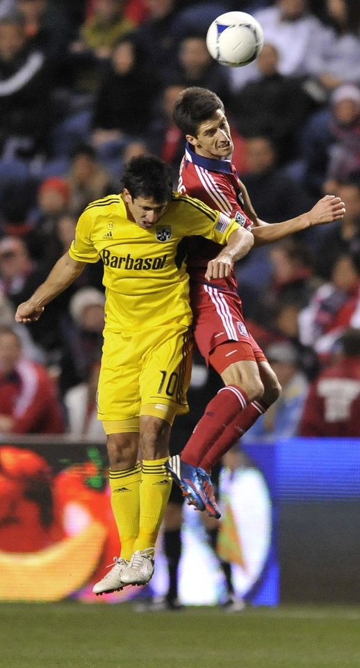Photo -   Chicago Fire's Alvaro Fernandez right, goes up for a header against Columbus Crew's Milovan Mirosevic during the first half of an MLS soccer match against the Columbus Crew in Bridgeview, Ill., Saturday, Sept. 22, 2012. (AP Photo/Paul Beaty)