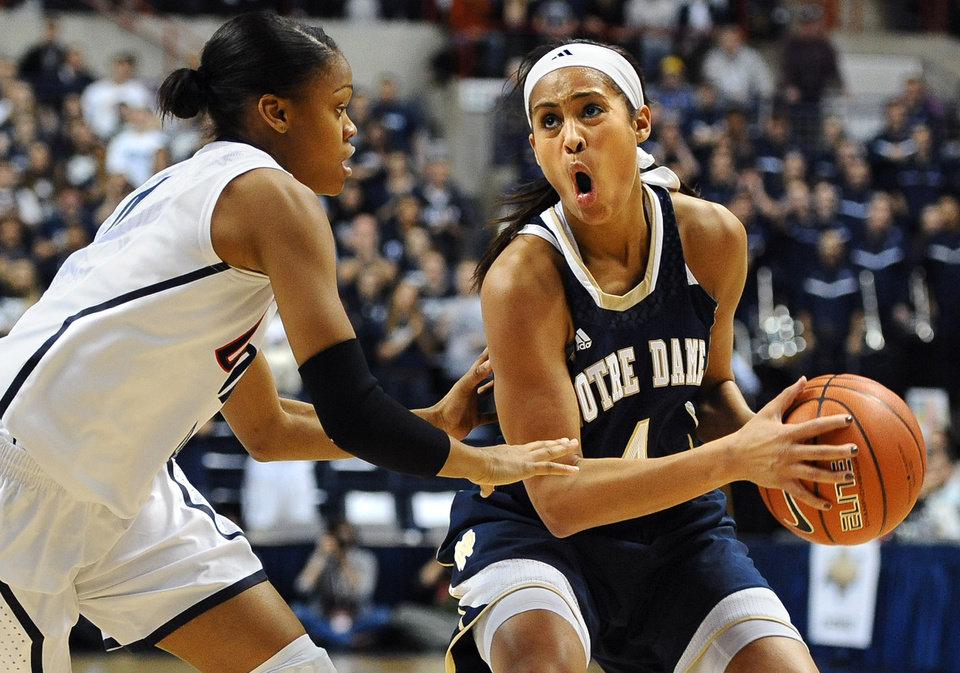 Notre Dame's Skylar Diggins, right, is guarded by Connecticut's Moriah Jefferson, left, during the first half of an NCAA college basketball game in Storrs, Conn., Saturday, Jan. 5, 2013. (AP Photo/Jessica Hill)