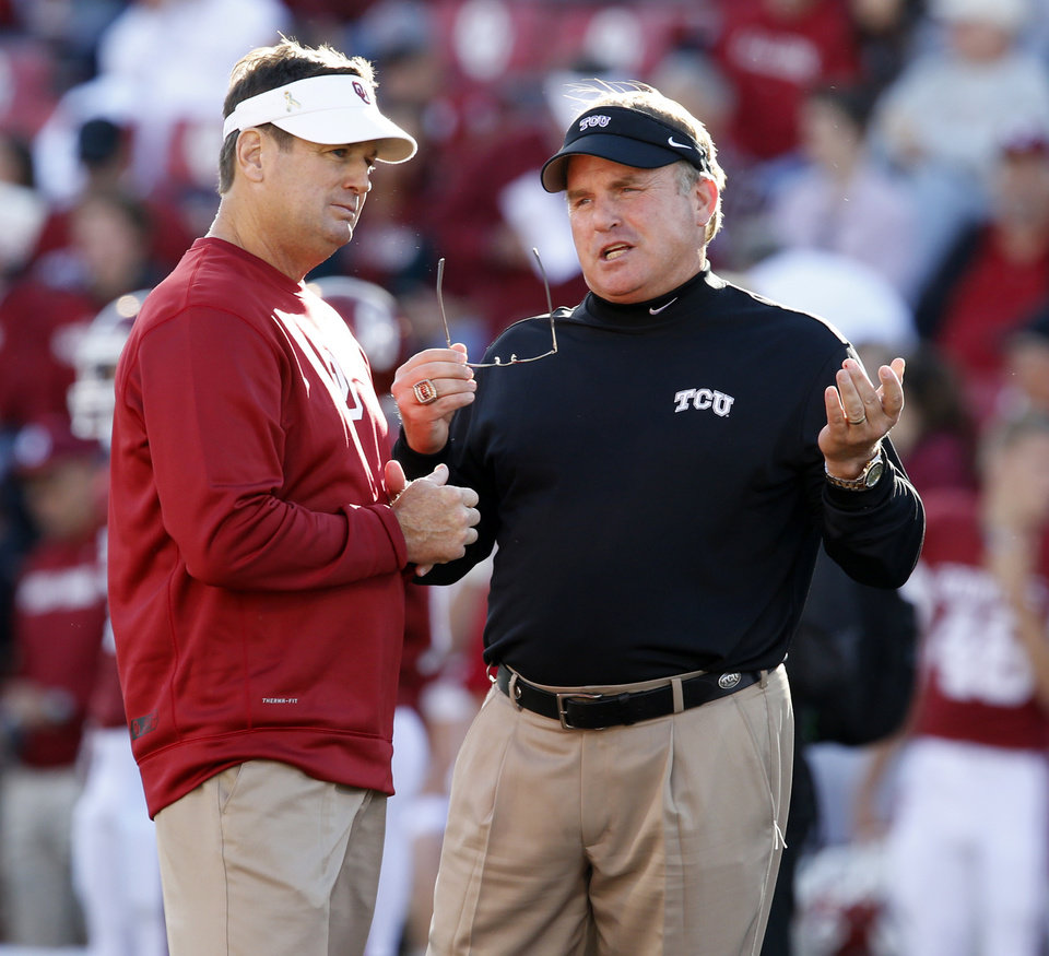 Photo - Head coaches Bob Stoops and Gary Patterson meet before a college football game between the University of Oklahoma Sooners (OU) and the TCU Horned Frogs at Gaylord Family-Oklahoma Memorial Stadium in Norman, Okla., on Saturday, Oct. 5, 2013. Photo by Steve Sisney, The Oklahoman