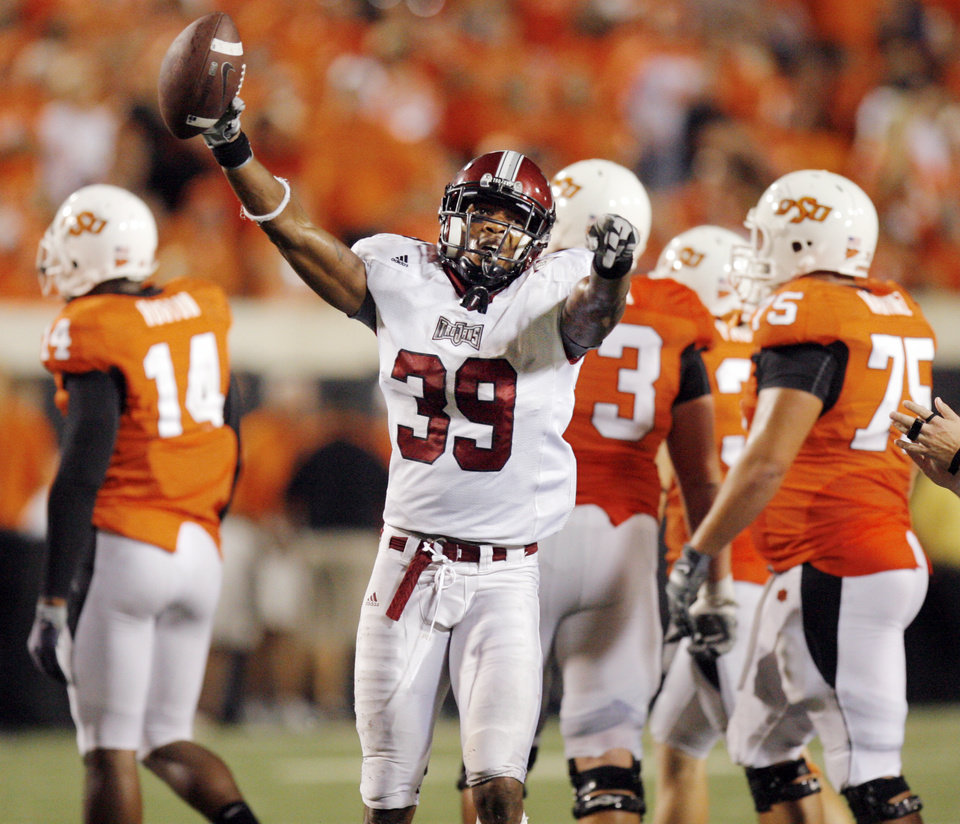 Photo - Troy's Daniel Sheffield (39) celebrates after recovering a fumble by OSU's Brandon Weeden (not pictured) as OSU was taking a knee to run out the clock in the fourth quarter during the college football game between the Oklahoma State University Cowboys (OSU) and the Troy University Trojans at Boone Pickens Stadium in Stillwater, Okla., Saturday, Sept. 11, 2010. OSU won, 41-38. Photo by Nate Billings, The Oklahoman