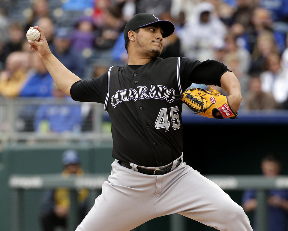 Photo - Colorado Rockies starting pitcher Jhoulys Chacin throws during the first inning of a baseball game against the Kansas City Royals Wednesday, May 14, 2014 in Kansas City, Mo. (AP Photo/Charlie Riedel)