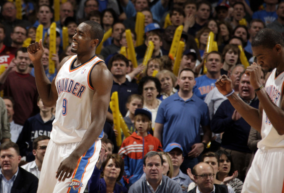 Oklahoma City\'s Serge Ibaka (9) and Kevin Durant (35) celebrate during the NBA basketball game between the Oklahoma City Thunder and the Denver Nuggets at the Chesapeake Energy Arena, Sunday, Feb. 19, 2012. Photo by Sarah Phipps, The Oklahoman
