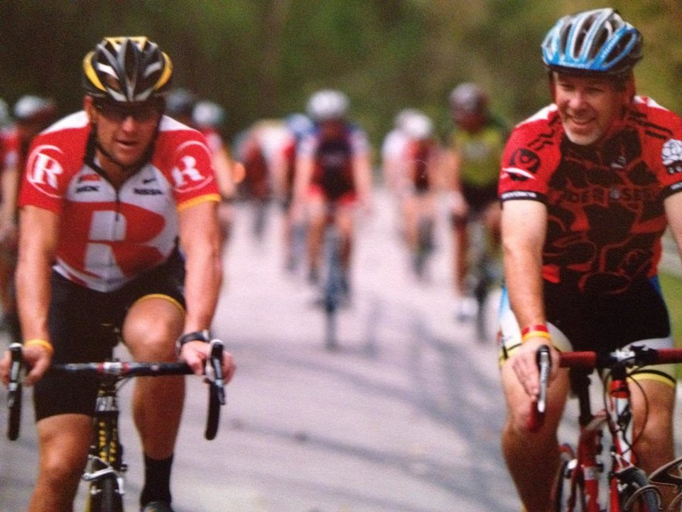 Photo - Lance Armstrong and Jerry Burnstein riding together in a Livestrong event. PHOTO PROVIDED