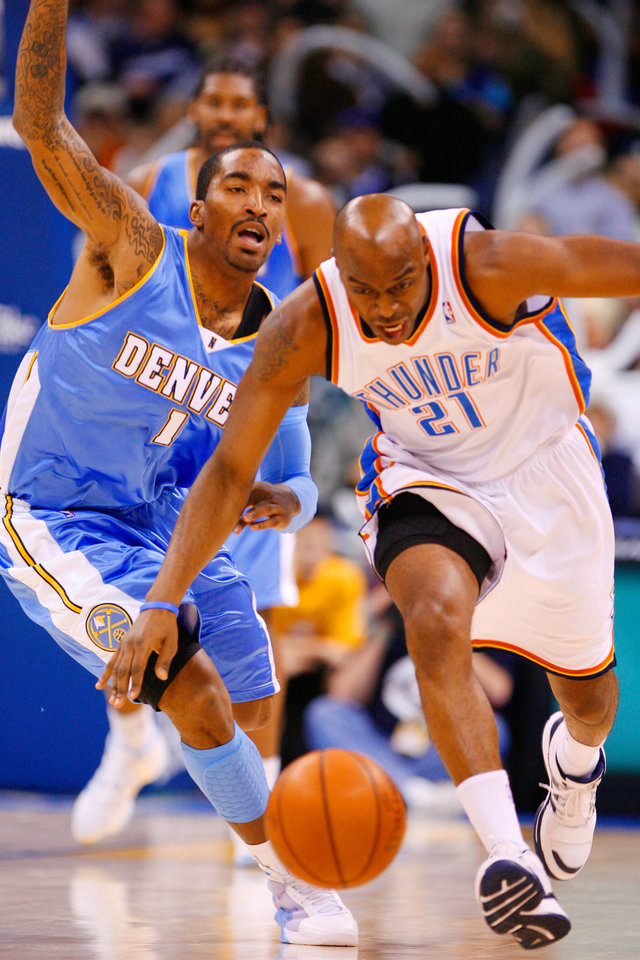Photo - Damien Wilkins tries to steal the ball from J.R. Smith in the second half as the Oklahoma City Thunder play the Denver Nuggets at the Ford Center in Oklahoma City, Okla. on Friday, January 2, 2009.  Photo by Steve Sisney/The Oklahoman