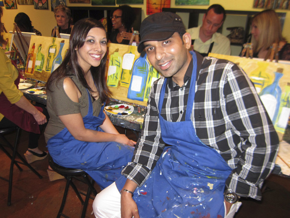 Photo - Customers are shown at Pinot's Palette in Houston.