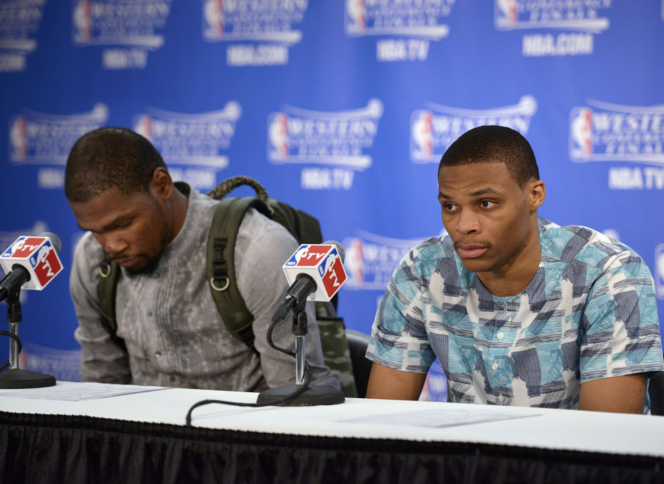 Photo - Oklahoma City Thunder's Kevin Durant, left, and Russell Westbrook, speak at a press conference after Game 5 of the NBA basketball Western Conference finals, Thursday, May 29, 2014, in San Antonio. San Antonio won 117-89. (AP Photo/Darren Abate)