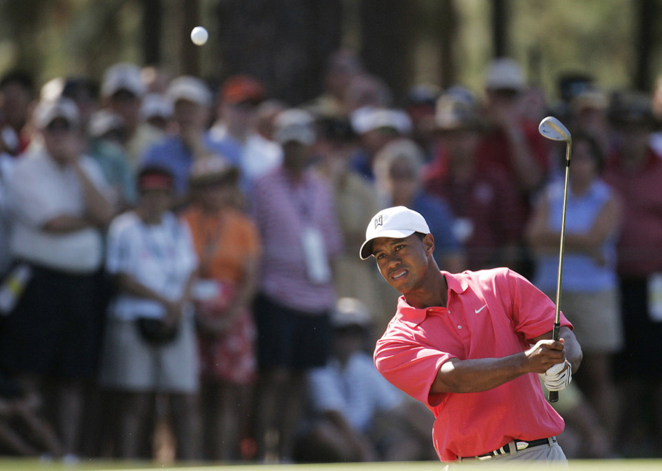 Photo - FILE - In this June 16, 2005, file photo, Tiger Woods chips to the 15th hole during the first round of the U.S. Open golf tournament, at Pinehurst's No, 2 Course in Pinehurst, N.C. Woods withdrew from the U.S. Open on Wednesday, May 28, 2014, as he recovers from back surgery that has kept him out of golf for nearly three months. It will be the second U.S. Open, and sixth major, he has missed because of injury over the last six years. The U.S. Open is June 12-15 at Pinehurst No. 2, where Woods tied for third in 1999 and was runner-up in 2005. (AP Photo/Julie Jacobson, File)
