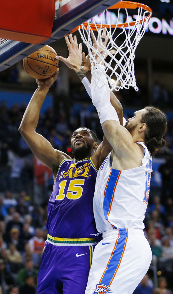 Photo - Oklahoma City's Steven Adams (12) defends Utah's Derrick Favors (15) during an NBA basketball game between the Utah Jazz and the Oklahoma City Thunder at Chesapeake Energy Arena in Oklahoma City, Monday, Dec. 10, 2018. Photo by Nate Billings, The Oklahoman