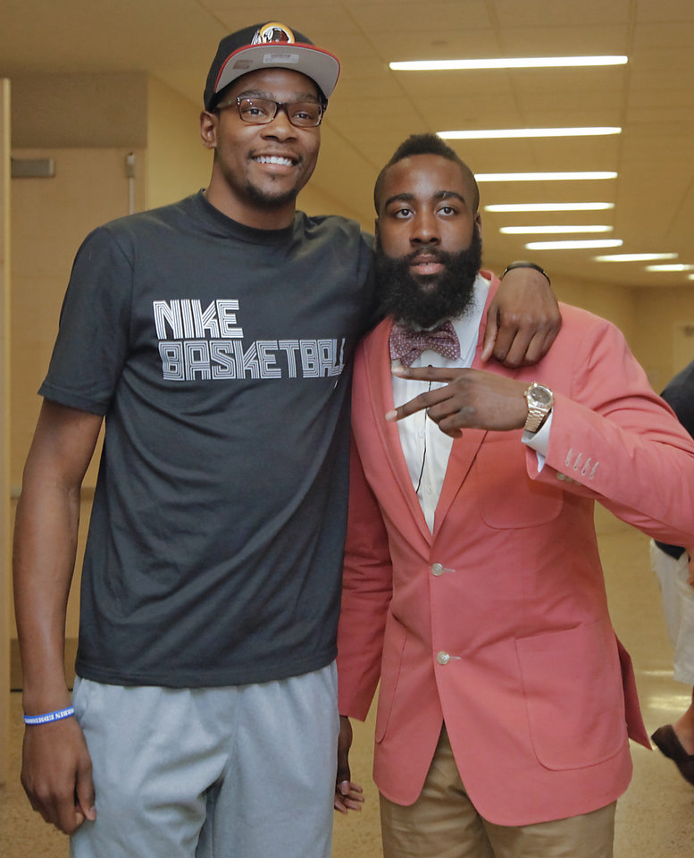 NBA BASKETBALL: Kevin Durant poses for a photo with teammate James Harden during the presentation of the 2012 NBA Sixth Man of the Year Award to the Oklahoma City Thunder\'s James Harden on Thursday, May 10, 2012, in Oklahoma City, Oklahoma. Photo by Chris Landsberger, The Oklahoman